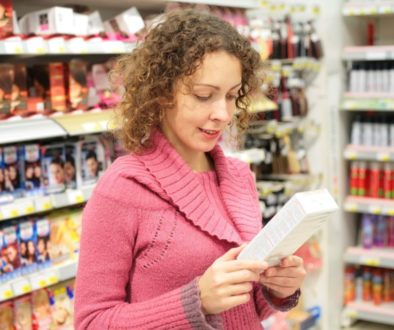 woman reading packaging label